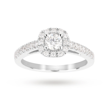 Brilliant cut 0.65 total carat weight diamond halo ring with diamond set shoulders in 18 carat white gold